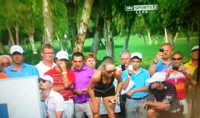 Caroline Wozniacki distracts proceedings at the World Golf Finals