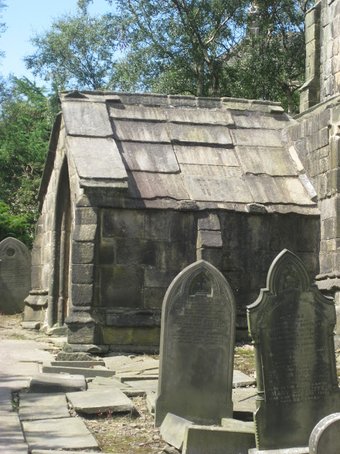 Gravestones being used as roofing tiles