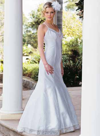 The vintage wedding dress designer dresses her with a beautiful selection of