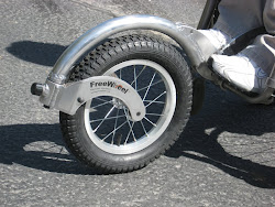 FreeWheel(tm) Wheelchair Attachment