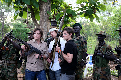 *Photo taken by photographer and total rockstar Glenna Gordon on the Sudan-Congo border in April 2008. Team not-so-invisible-children poses with the SPLA& and their weapons.
