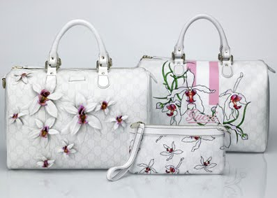 gucci bags for kids. the collection comprises 2 boston bags and a wristlet, all with this orchid theme. \ gucci for kids