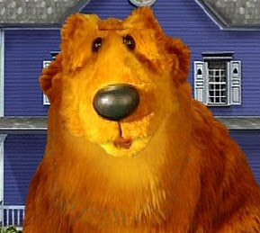 Bear in front of his Big Blue House