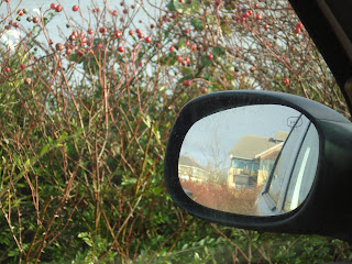 A view out of the passenger door with different reflection in the wing mirror