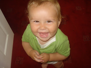 Smiling Baby Boy in a Green T-shirt