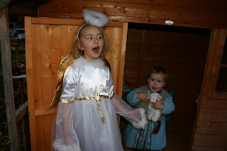 Top Ender dressed as an Angel with Baby Boy dressed as a shepherd singing Christmas Carols