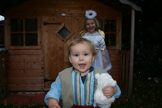Top Ender dressed as an Angel with Baby Boy dressed as a shepherd walking to the camera