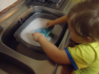Baby Boy doing the Dishes