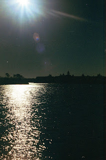 Photo of Moonrise over water