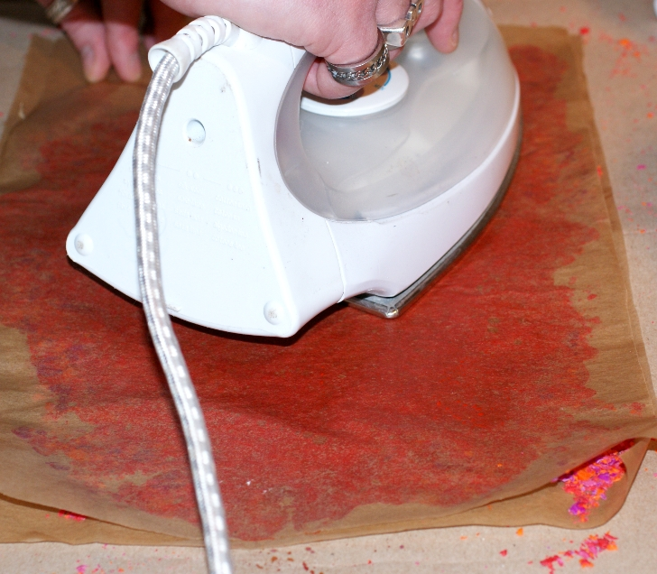 how to get melted crayon out of clothes with iron