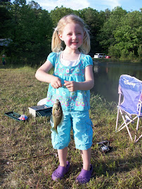 Laurie catching a fish