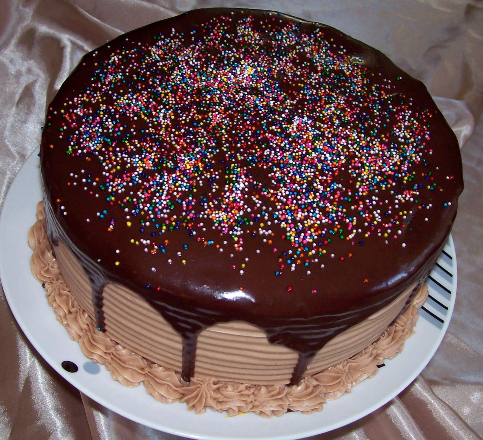 A Triple Chocolate Fudge Birthday Cake With Filling And Icing Topped Ganache Few Sprinkles Plain Simple But Delicious