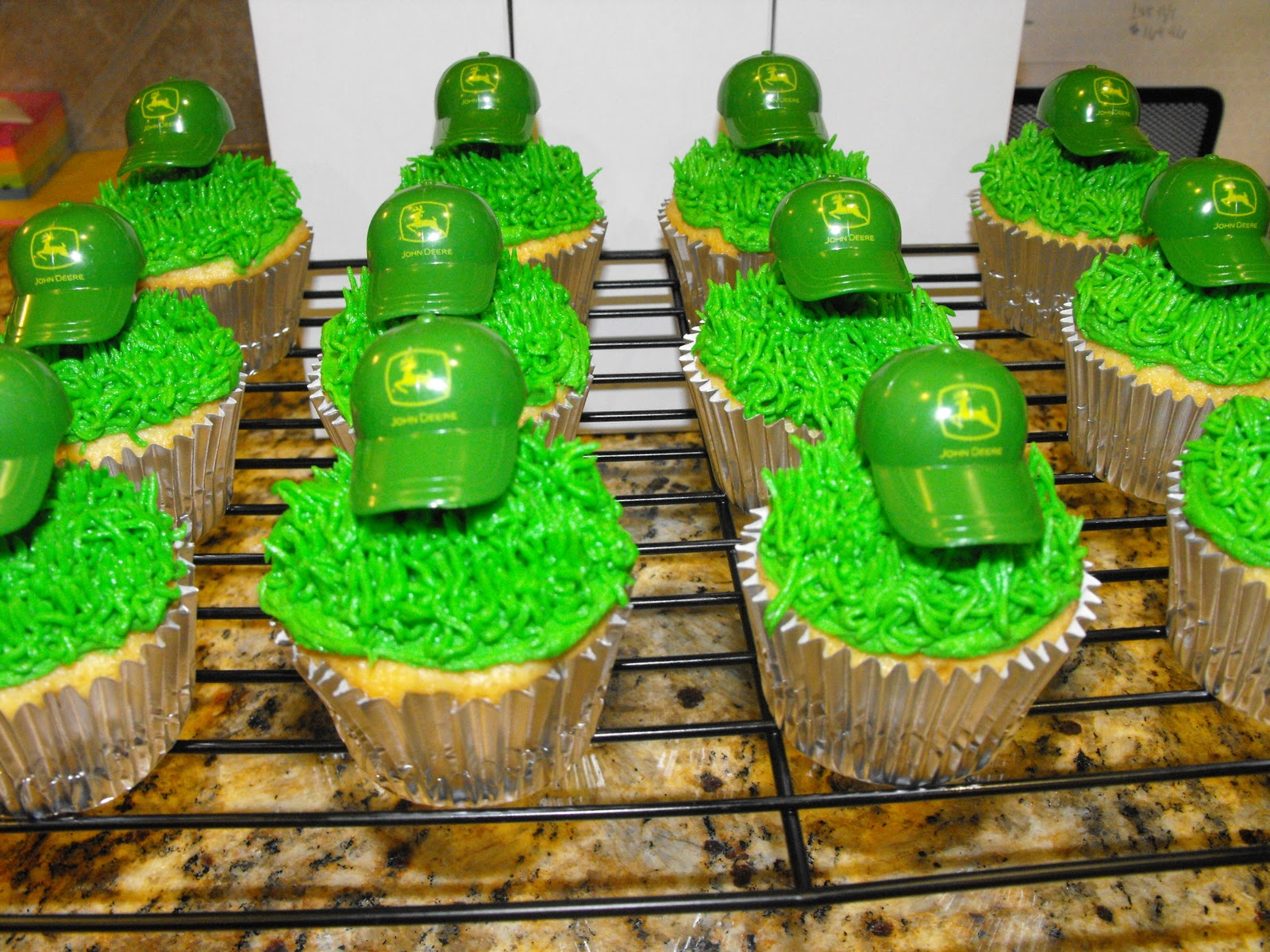 This is a photo of Hilaire John Deere Cupcake Toppers