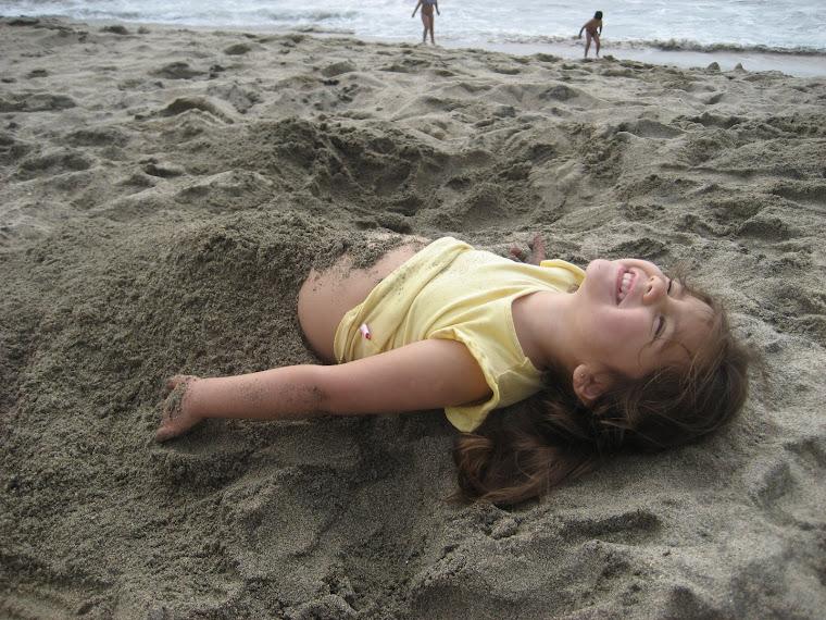Enterrada en la arena