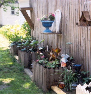 Lovemyjunk recycled planters and yard art - Flower planters for fences ...