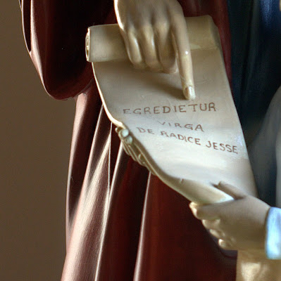 Close up picture of scroll with Latin inscription Egredietur virga de radice Jesse.