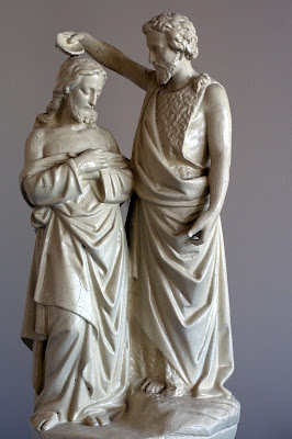 Small statue of John the Baptist baptising Jesus
