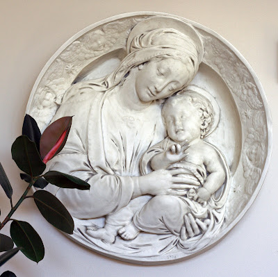 Large white plaster relief medallion of Madonna and Child