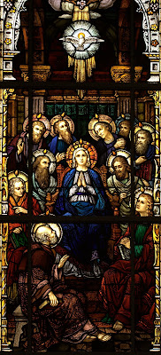 Stained Glass window of Mary and the Deciples receiving the Holy Spirit at Pentecost