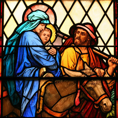 Close up of stained glass window with Mary, Joseph, Jesus and Donky fleeing to Egypt
