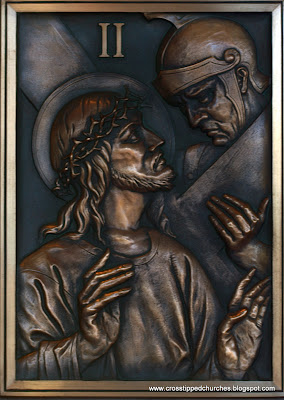 Bronze relief of sation 2 of the Stations of the Cross.