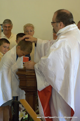 Child being baptised.
