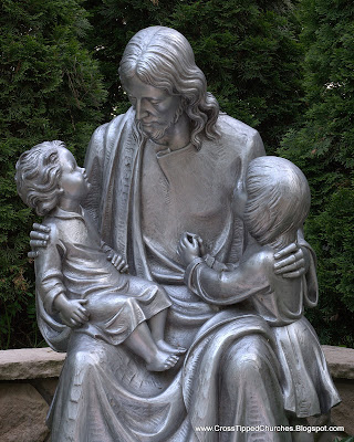 Day shot of statue of Jesus holding children