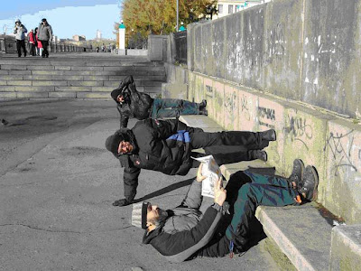 Men lying on road - Perspective 2