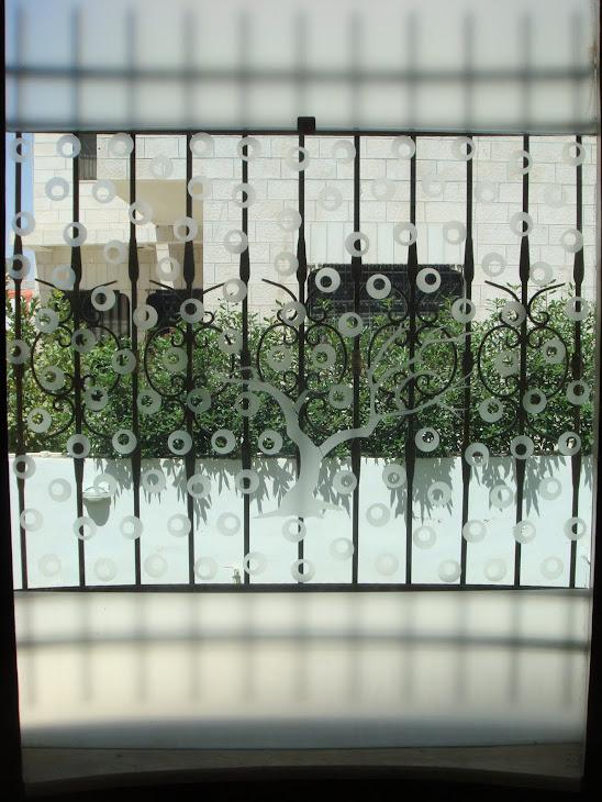 سيكوريت مروحه ابواب زجاج سيكوريت محلات باب فاصل زجاجي تشكيلات زجاج