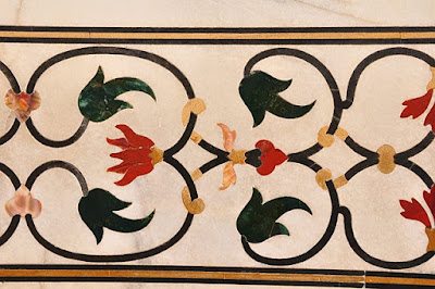 Floral designs inlaid with stone, south portal