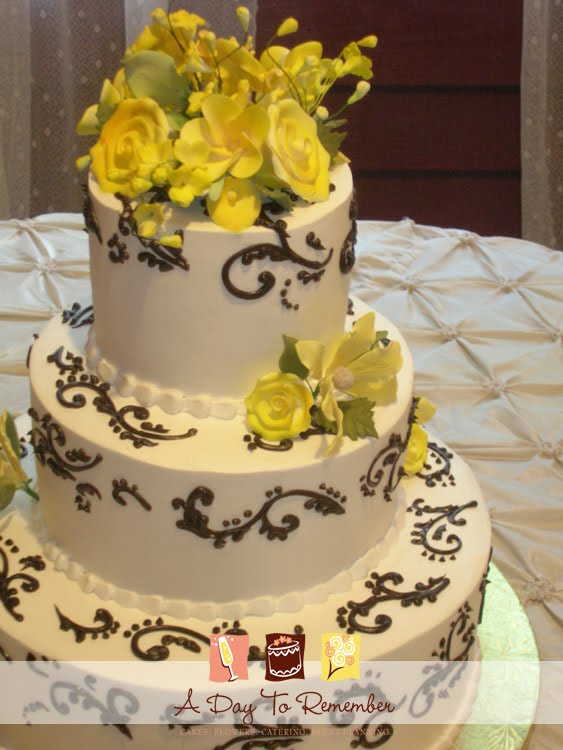 The wedding cake was designed in black scrollwork and accented with a