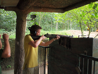 animals with guns shooting. by shooting some guns at