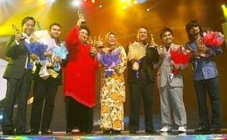 Winners (from left): Hazami, Azlan Abu Hassan, Adibah Noor, Habsah Hassan, Ayob Ibrahim, Zahid and M. Nasir with their trophies at Stadium Putra Bukit Jalil.