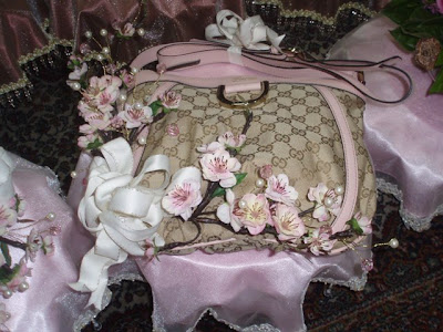 The wedding ring on a mini dais accompanied by crystal swans The Handbag
