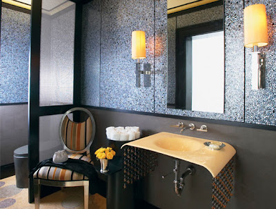 elegant bathroom with vanity, bathroom lighting
