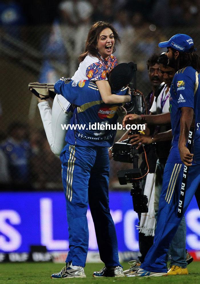 Nita Ambani celebrates as she is lifted by Harbhajan Singh.
