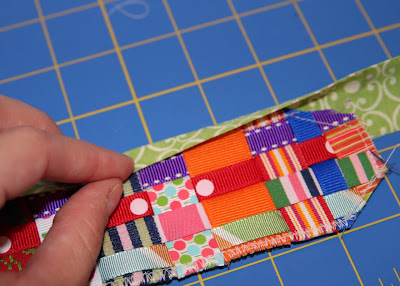 Scrap Ribbon Camera Strap Cover (A Tutorial) step 6 via lilblueboo.com