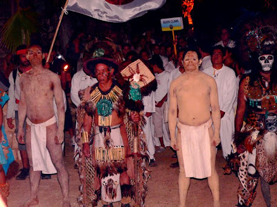 Mayan leaders head up the procession of villagers attending the opening