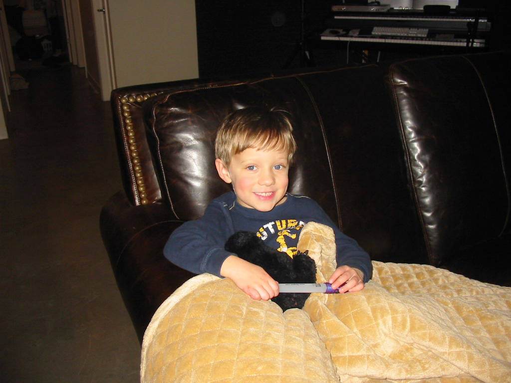 [the+boy+and+the+new+couch.jpg]