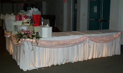 Party people event decorating company wedding fabric swaging for flowers on the corner of the gift table by hand picked located in winter haven negle Gallery