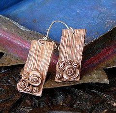 lorena angula metal bronz clay earrings