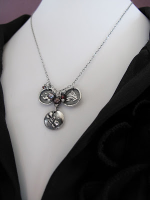 silver charm necklace queen bee hint
