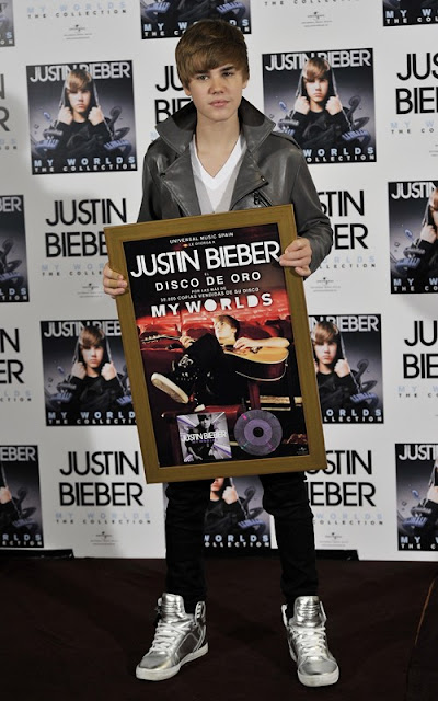 Justin Bieber being presented a gold album in Madrid, Spain photo