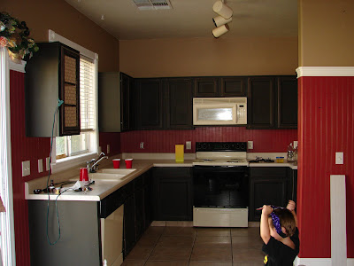 first painted the cabinets red and then decide to paint them black
