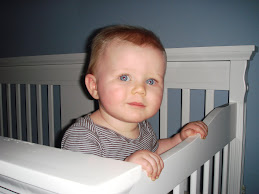 Loves standing in his crib