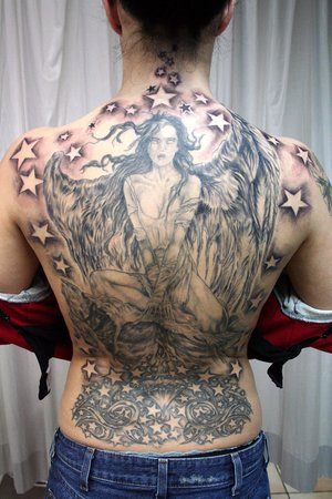 full back tattoo wings. lower ack tattoos wings. with