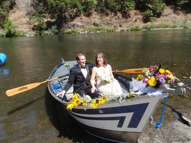 Bride and groom afloat in nature