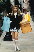 Hey look! A reason to post a picture of Alicia Silverstone! And I need to convince my wife to wear that skirt...
