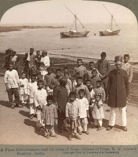 India 100 years ago: A Parsi schoolmaster and his class of boys - Island of Uran, N.W. toward Bombay (Mumbai), India