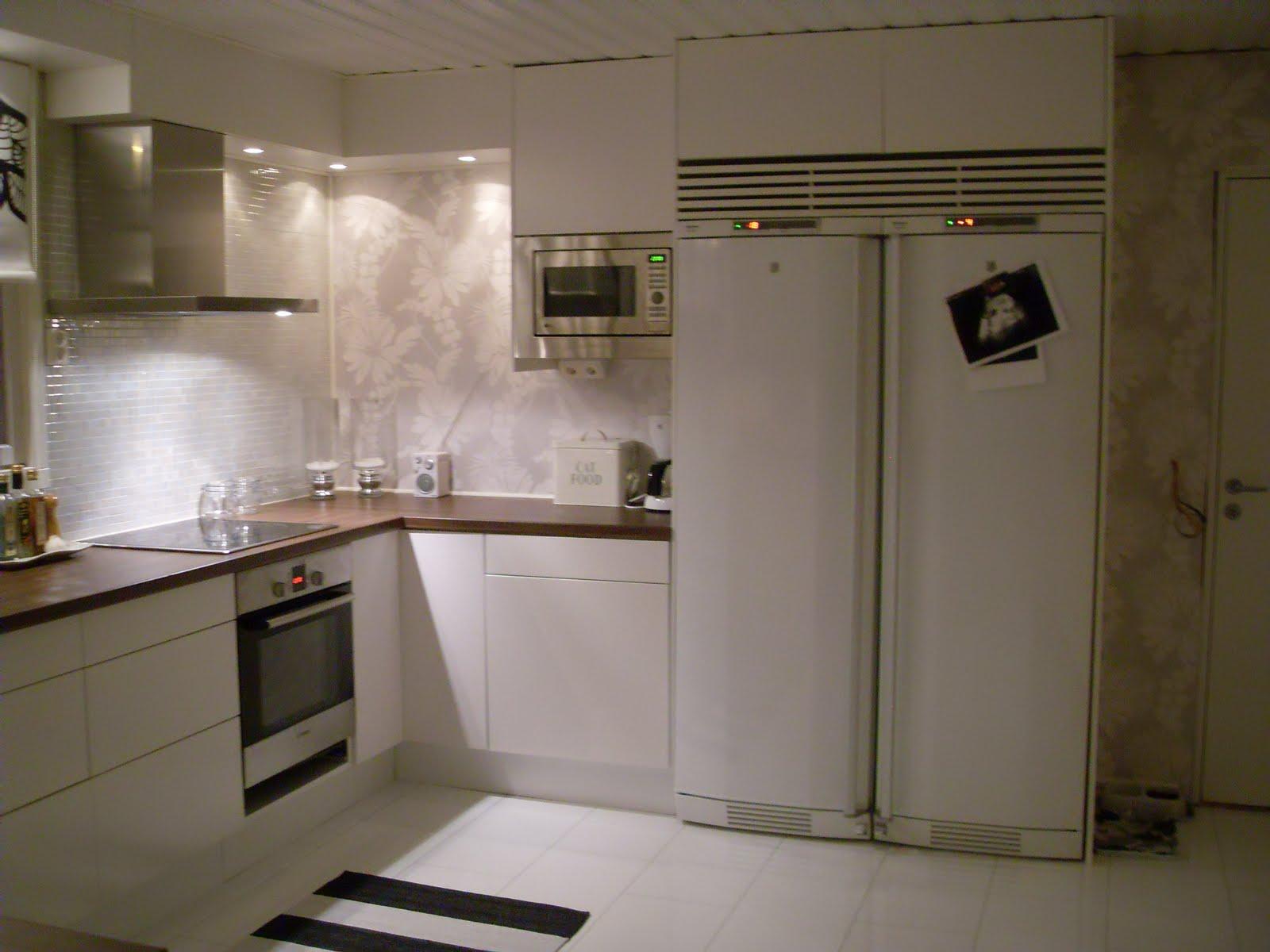 Renovering och inredning av ett vitt hus vid havet: köket